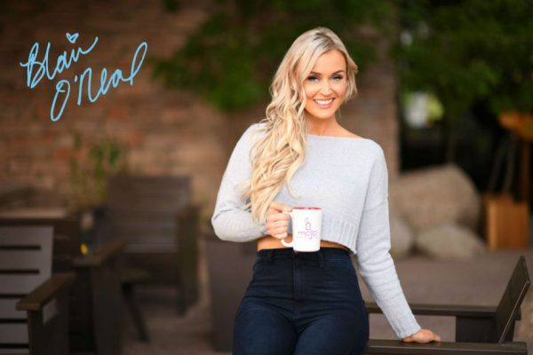 Signature card - Blair O'Neal with a cup a coffee